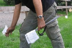 Setting up electronic boundary fencing (marked by white flags)